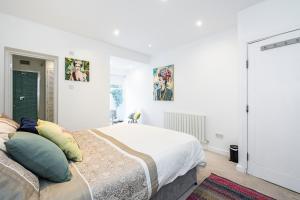 Stylish garden apartment Nr High Street Kensington, Ferienwohnungen  London - big - 11