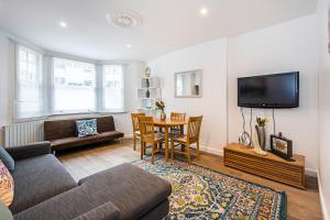 Stylish garden apartment Nr High Street Kensington, Ferienwohnungen - London
