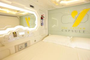 The Yellow Capsule Hotel Boutique & Beach Club