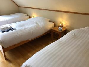Rusutsu Lodges Pension Lilla Huset - Hotel - Rusutsu