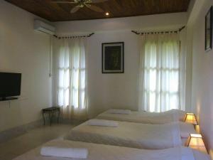 Villa Thakhek, Penziony  Thakhek - big - 218