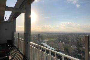Attico Grattacielo - AbcAlberghi.com