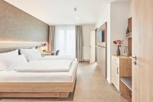 Gästehaus Bauer - Schlafen auf dem Weingut, Отели типа «постель и завтрак»  Хайльбронн - big - 4