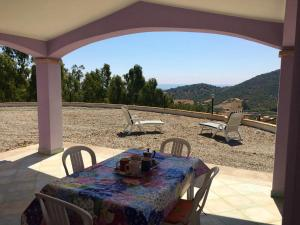 House with 2 bedrooms in Cardedu with wonderful sea view enclosed garden and WiFi 1 km from the beach