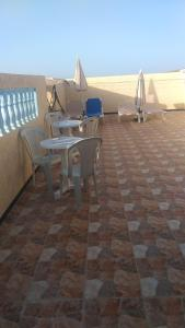 House with 2 bedrooms in Mirleft with wonderful city view and furnished terrace 500 m from the beach