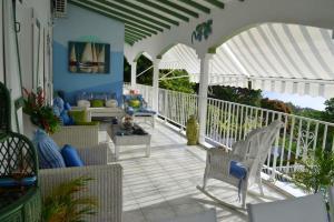 Propriete de 3 chambres a Deshaies avec magnifique vue sur la mer piscine partagee jardin clos a 2 km de la plage