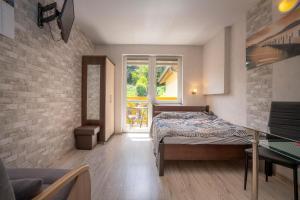 DOMINO pokoje i apartamenty