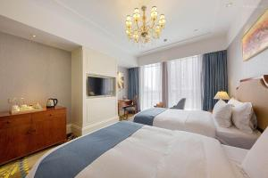 Yuyao Teckon Ciel Hotel (Yuyao Wanda Plaza store), Отели - Yuyao