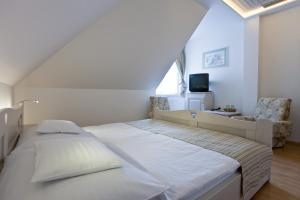 Tornácos Ház - Hegykő, Hotely  Hegykö - big - 53