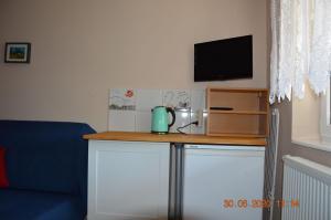 Apartamenty i pokoje u Kryni