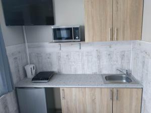 Kawalerki z Kuchnią self check in Studios with Kitchen