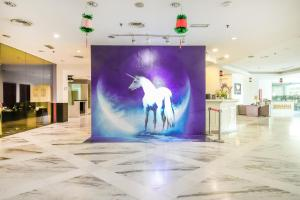 OYO Capital O 89357 Unicorn Hotel
