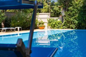 Appartamento con piscina a Marina Centro - AbcAlberghi.com