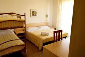 New Hotel Cirene Room Quadriple with breakfast - AbcAlberghi.com