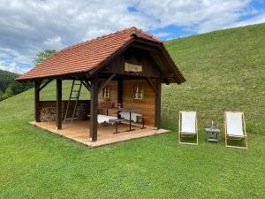 Wooden hut at tourist farm Artisek