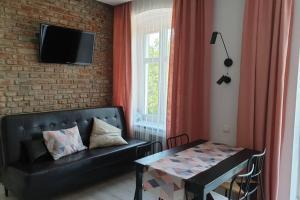 Apartament w kamienicy Przy Plantach