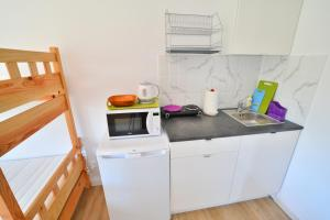 Pokoje z łazienką i aneksem kuchennym Sofia