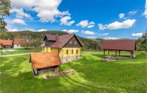 Beautiful home in Kocevska Reka with 4 Bedrooms