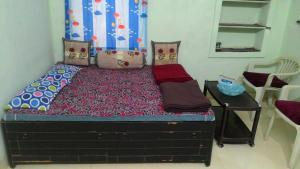 Shri Niwas, Room 'A' with Balcony & Attached Toilet Bath.