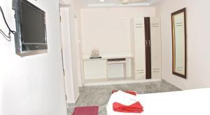 Raya's Executive Homes, Мини-гостиницы  Кумбаконам - big - 7