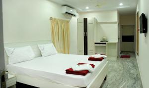 Raya's Executive Homes, Мини-гостиницы  Кумбаконам - big - 9