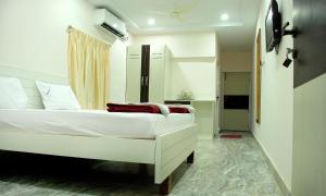 Raya's Executive Homes, Мини-гостиницы  Кумбаконам - big - 11