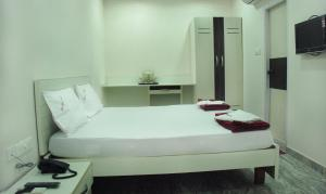 Raya's Executive Homes, Мини-гостиницы  Кумбаконам - big - 12