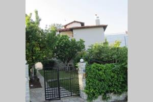 Traditional Apartment part of a Detached Villa on a luxurious Hill of Thessaloniki PANORAMA with a private garden with trees ,also available for weddings , parties and christenings