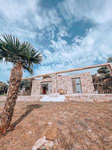 Stone built house next to the beach Ammouliani Greece