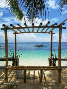 One Beachfront Room in Daanbantayan with Stand fan