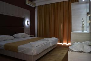 Karavos Hotel Apartments, Aparthotels  Archangelos - big - 42