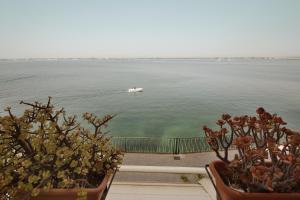 Alfeo apartament seafont Ortigia - AbcAlberghi.com