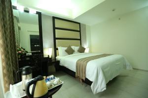 Pattom Royal Hotel, Отели  Тривандрум - big - 27