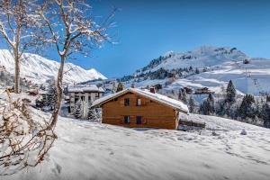 Location gîte, chambres d'hotes Mountain charm chalet panoramic views & sauna near slopes - OVO Network dans le département Haute Savoie 74