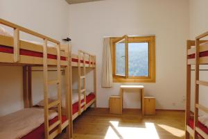 Bed in 6-Bed Dormitory Room Scuol Youth Hostel