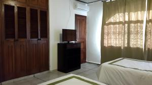 Deluxe King Room Suites & Apartments San Benito - Zona Rosa