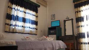 Гостиница Гомера Инн (Хора де Иос)