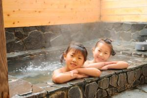 Garland Court Usami Private Hot Spring Condominium Hotel, Apartmanhotelek  Ito - big - 1