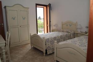 Camera Matrimoniale/Doppia con Letti Singoli con Balcone
