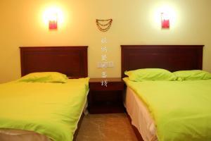Dengba Hostel Xishuangbanna Branch, Hostelek  Csinghung - big - 13