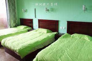 Dengba Hostel Xishuangbanna Branch, Hostelek  Csinghung - big - 16