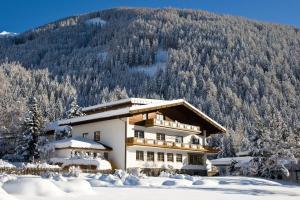 Ferienhaus Alpina - Hotel - Kals am Großglockner