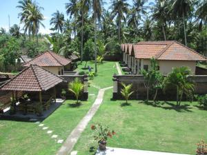 Yuli's Homestay, Проживание в семье  Кута, остров Ломбок - big - 10
