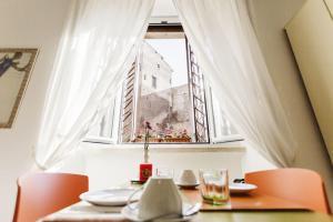 Maison Colosseo (Via dei Querceti 24) - abcRoma.com