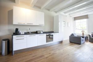 Hugo Apartments.  Foto 4