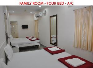 Raya's Executive Homes, Мини-гостиницы  Кумбаконам - big - 13