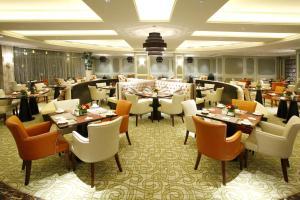 Landison Green Town Hotel Xinchang, Hotely  Xinchang - big - 6