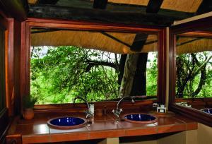Lianshulu Lodge, Chaty v prírode  Luzibalule - big - 8