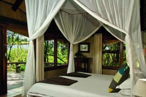 Lianshulu Lodge, Chaty v prírode  Luzibalule - big - 14