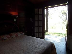 Pousada Canto do Lago, Гостевые дома  Пиракая - big - 99